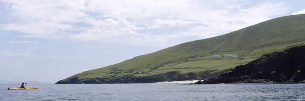 The photo shows Ciarán Walsh approaching the Blasket Island in a kayak. It was taken on10 July 2013 by Padraig O'Donoghue. The Great Blasket lies off the coast of Ireland, just north of the town of Dingle. In 2013 Ciaran Walsh, director of the heritage project management company www.curator.ie, edited a book of photographs from the collection of the Great Blasket Centre (An Island Portrait by Micheál de Mórdha and Dáithí de Mórdha and published by Collins Press). The islanders were famous for their prowess with the 'naomhóg,' an open canoe up to 19 feet long and rowed by a crew of three. It was very different from the sea-kayak being rowed by Ciarán Walsh but the journey across the Blasket Channel. notorious for strong currents, was no less challenging.