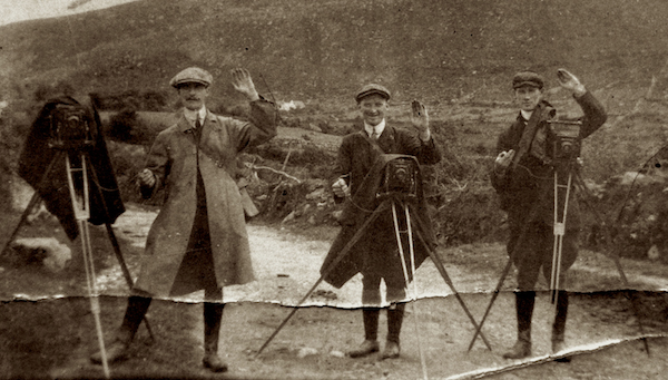 The photograph shows Daniel MacMonagle (centre) in the Gap of Dunloe in 1913 with photographers Louis Anthony and Franz Haselbeck. Ciarán Walsh / www,curator.ie is currently working on a piece for the Irish Independent on 100 years of photography by the MacMonagles of Killarney. A centenary exhibition opens in the Library in Killarney on 6 July 2013.