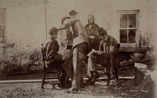 The Irish Headhunters in action, Charles R. Browne and And Alfred Cort Haddon measuring the physical characteristics - eye and hair colour, pigmentation, head size and so on - of the 'Aranites,' taken to illustrate the field work undertaken by the Anthropometry Laboratory of TCD during the ethnographic survey of 1891 -3. A written report of the survey was published by the Royal Irish Academy in 1893. Haddon (?) is using a Flowers Craniometer to measure the lenght of the subject's face while Browne enters the information into specially prepared index cards.