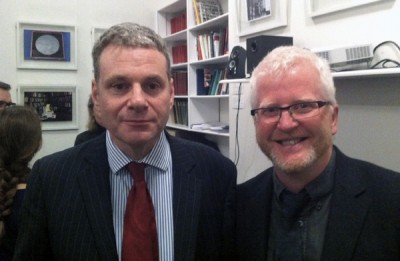 The photo is a mid-shot double portrait of David Shankland, Royal Anthropological Institute, and Ciaran Walsh, www.curator.ie. The photo was taken by Dan Hicks by Dan Hicks at the workshop on the history of the RAI in London on 8th and 9th December 2015.