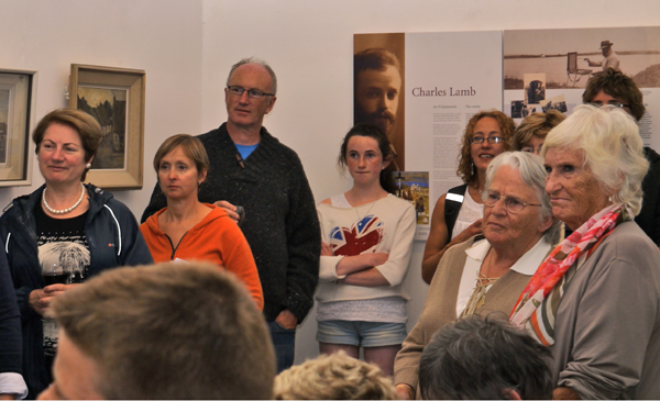 Laillí and Mary Lamb (right of picture) at the opening of a selection of paintings by their father Charles Lambe (1893–1964) in Aras Éanna, Inis Oirr, the Aran Islands on 2 August 2013. The exhibition was hung by Ciarán Walsh of www.curator.ie. The photographs shows a section of the audience that includes the Samb sisters.