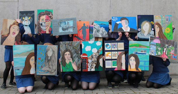 Photograph of 5th Year students (aged 16+) holding their self-portraits, A2 sized multimedia works, which will go on show in the school as part of the Ár Ré-na exhibition.. Pobalscoil Chorca Dhuibhne is an all Irish community school in Dingle, County Kerry. www.curator.ie has been working with the students and their art teacher, brenda Ní Frighil, on the preparations for the exhibition.